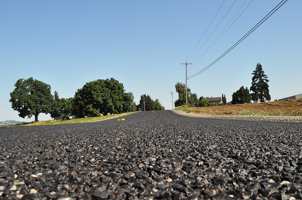 Low angle shot of the newly paved road in all it's glory.