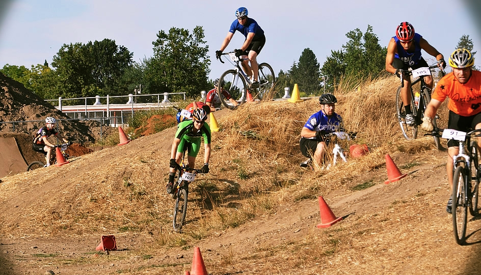 Racers negotiate the quick double up and over in the 2nd Race of the LifeSource Natural Foods MTB Salem Short Track Series at the Oregon State Fairgrounds.