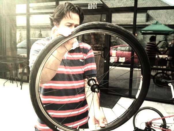 Conrad's front wheel...flat on his first day of commuting.
