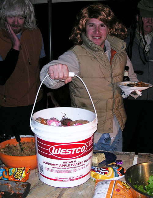 Pat's training for Halloween Cross Races - a wig and a bucket of doughnuts. Genius.