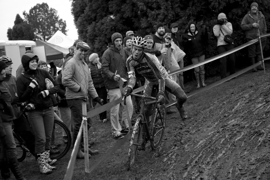 James bombing down the crazy muddy off camber crash zone. The crowd roared when he flew through. Photo copyright PDXCross.