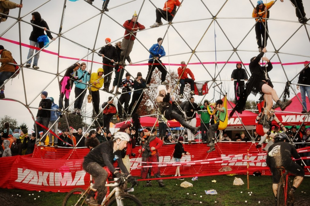 Fans and ruffians climb onto the Thunderdome to 'encourage' riders passing through.